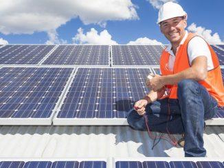 19798542 - solar panel technician on roof